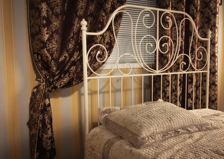 Old style bed in the elegant bedroom Stock Photo - 16884024