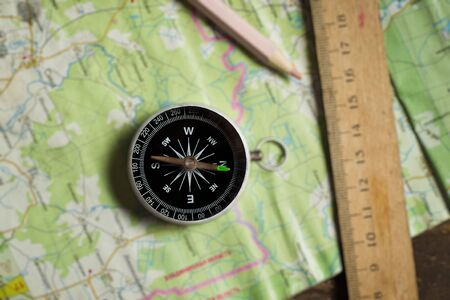 Compass, ruler and pencil on a map photo