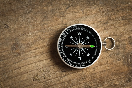 compass rose: Compass on a wood deck