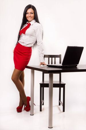 Happy business woman in a office over white Stock Photo - 16886308