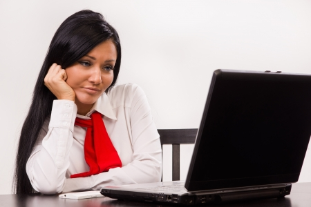 attitude girl: Distraught office girl behind a laptop Stock Photo