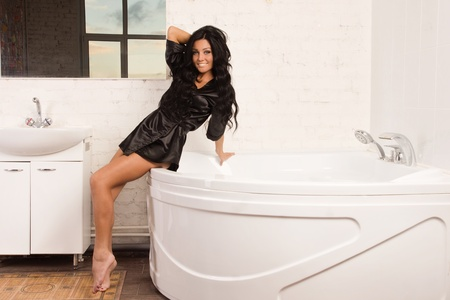 Beautiful brunette spa woman in the bathroom Stock Photo - 16906445