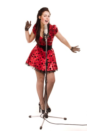 Pin-up girl with a microphone on stage singing a song