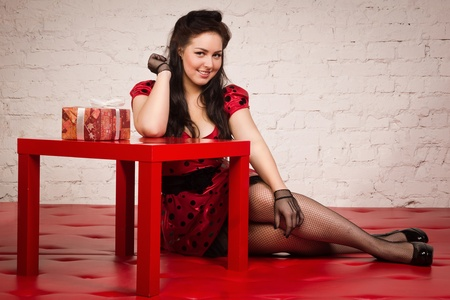 Happy pin-up girl with gift Stock Photo - 17449905