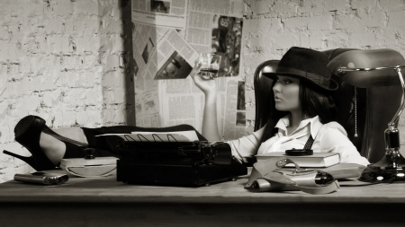 Retro detective girl sits at a table in the agency Stock Photo - 17449900