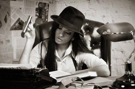 Retro detective girl in the detective agency Stock Photo - 17449907