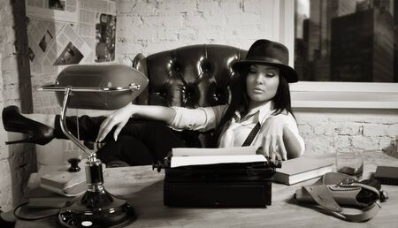 Retro detective girl sits at a table in the agency Stock Photo - 17449894
