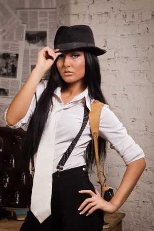 Retro detective girl on a wall background Stock Photo - 17449871