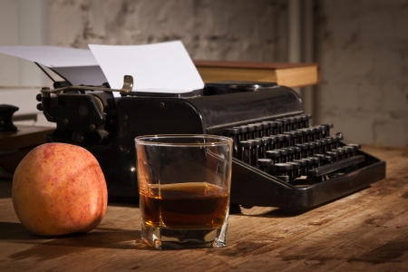 correspond: Vintage still life with old typewriter. Focus on the glass