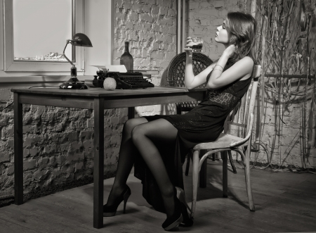 Elegant woman in black at the table with the old typewriter Stock Photo - 17457931