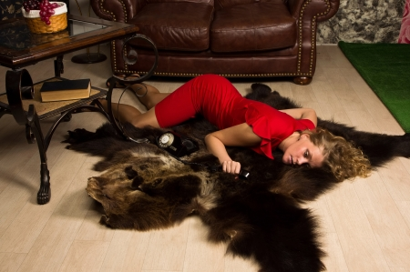 fetish woman: Crime scene simulation: lifeless blonde in the red dress lying on the floor Stock Photo