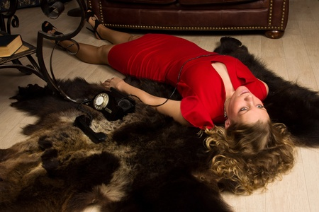 homicide: Crime scene simulation: lifeless blonde in the red dress lying on the floor Stock Photo