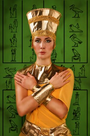 Portrait of beautiful egyptian woman in costume of the Pharaoh photo