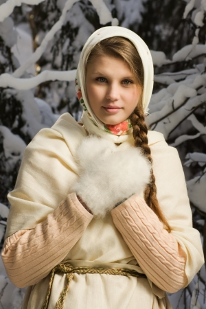 russian ethnicity caucasian: Russian beautiful girl in a traditional dress in the winter forest Stock Photo