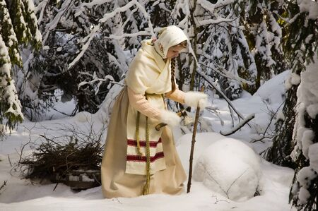 Russian girl with a sled in the winter forest Stock Photo - 18411789