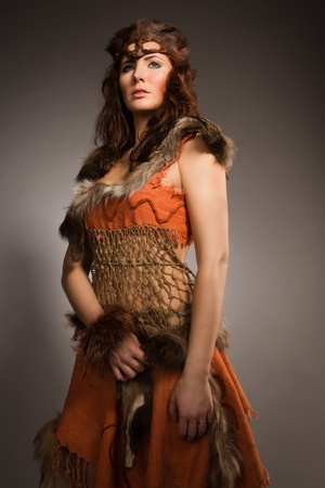 Young woman in a fur suit of the amazon photo