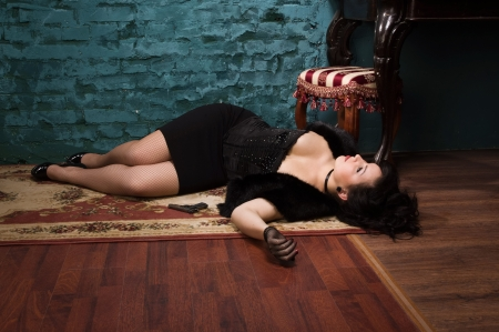 Crime scene in a vintage style. Victim lying on the floor photo