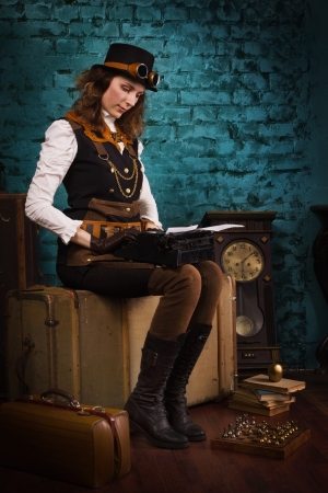 Steam punk girl and old typewriter in a vintage room photo