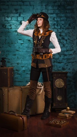 Steam punk girl with binocular in the hands photo