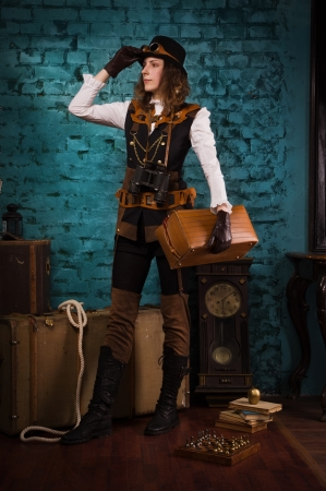 Steam punk girl with suitcase in the hands photo
