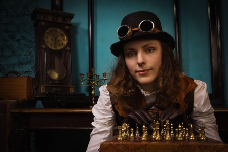 Steam punk girl in a vintage room plays chess Stock Photo - 18513425