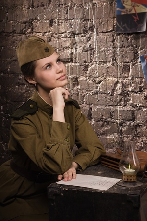 russian hat: Soviet female soldier in uniform of World War II dreams Stock Photo