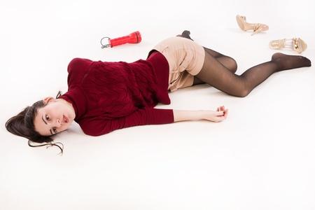 corpse: Lifeless brunette in red lying on the floor