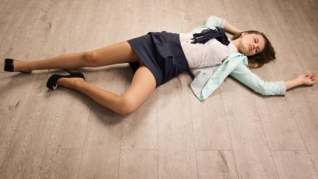 victim: Crime scene simulation: college girl lying on the floor