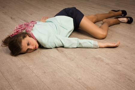 hostage: Crime scene simulation: college girl lying on the floor