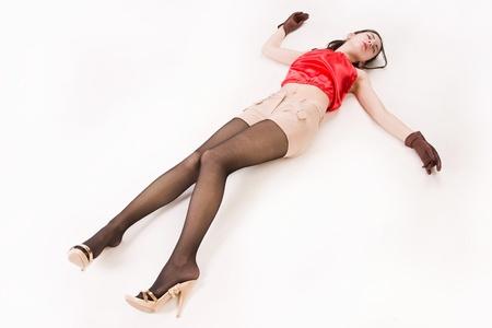 Lifeless brunette in red lying on the floor