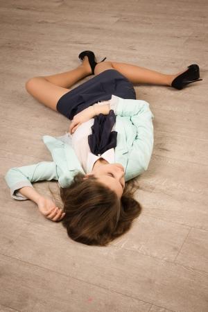 strangled: Crime scene simulation: college girl lying on the floor