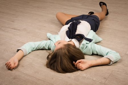 Crime scene simulation: college girl lying on the floor photo