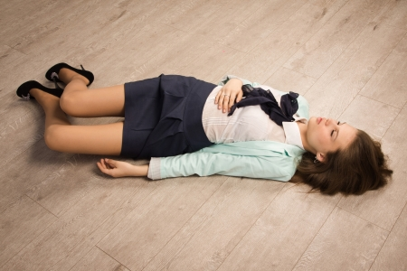 actress girl: Crime scene simulation: college girl lying on the floor