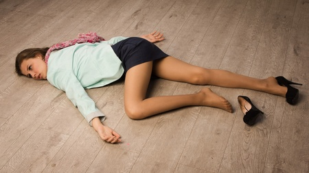 homicide: Crime scene simulation: college girl lying on the floor