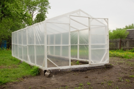 Rural greenhouse in a garden photo