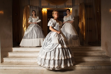 Picture of three young women in ball gowns photo
