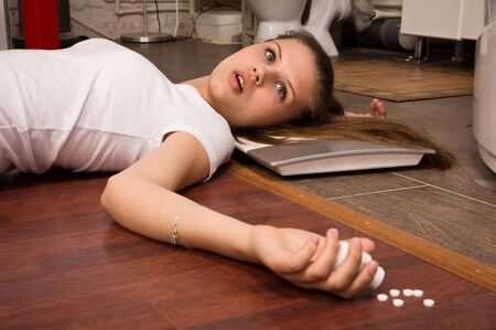 overdose: Crime scene simulation: overdosed victim lying on the floor