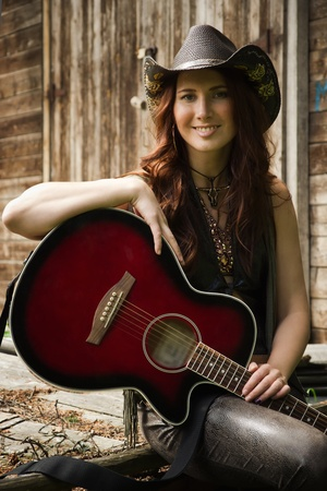 country girls: Pretty country girl with guitar on the ranch
