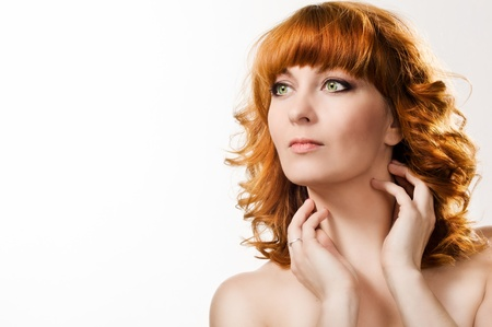 Portrait of the beautiful woman with red hair photo