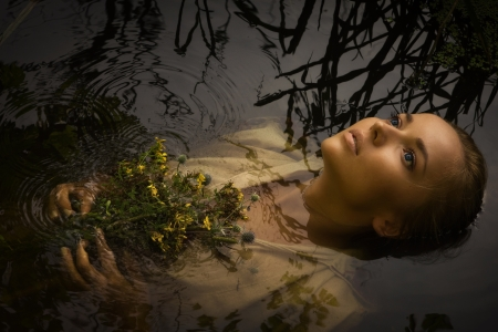 Young drown woman in a poetic representation. 스톡 콘텐츠