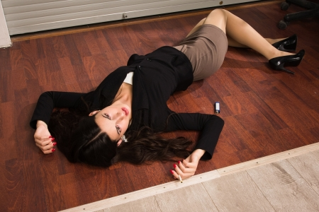 business crime: Crime scene in a office with lifeless businesswoman lying on the floor Stock Photo