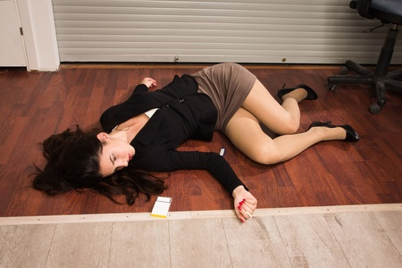 murdering: Crime scene in a office with lifeless businesswoman lying on the floor Stock Photo