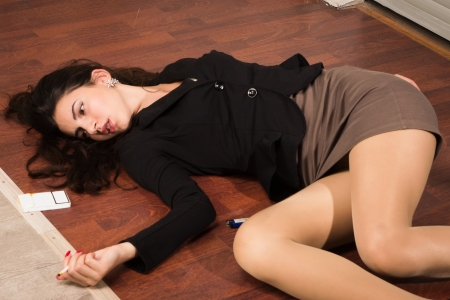 strangulation: Crime scene in a office with lifeless businesswoman lying on the floor Stock Photo