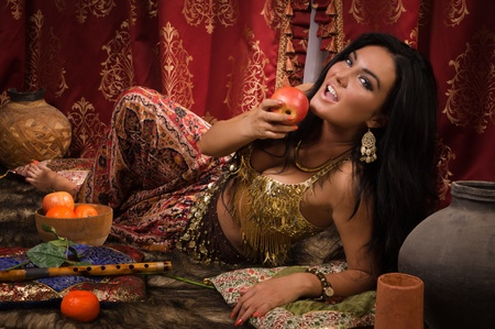 Beautiful arabic woman in the arabic harem interior photo