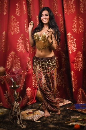 Arabic woman belly dancer dancing photo