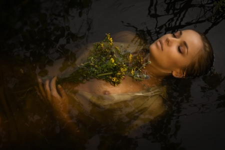 murder: Young drown woman in a poetic representation. Stock Photo