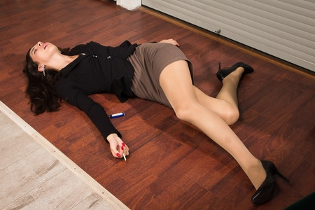 coroner: Crime scene in a office with lifeless businesswoman lying on the floor Stock Photo