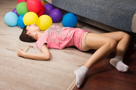 Crime scene imitation. Lifeless woman lying on the floor photo
