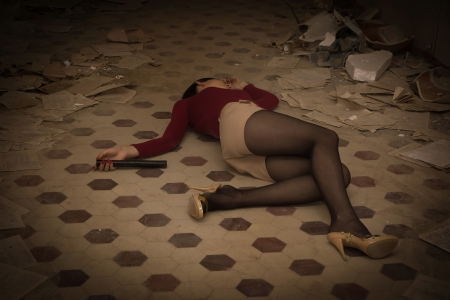 corpse: Lifeless brunette in red lying on the floor  Stock Photo