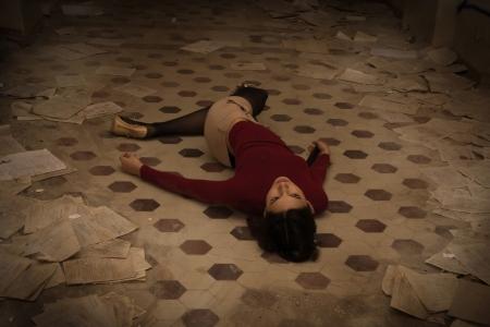 strangle: Lifeless brunette in red lying on the floor